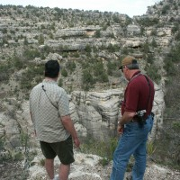 Dan Lorraine and Rick Lynch view cliff dwellings within Walnut Canyon