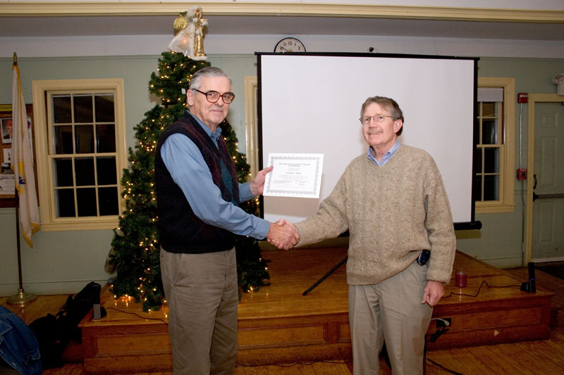 Dave Hurdis presents Gerry Dyck with a certificate commemmorating his 150,000th variable observation