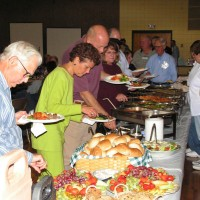Guests make their way through the buffet at the Saturday evening program