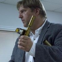 John Briggs shows an antique spectroscope used for microscopy