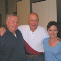 Glenn Jackson and Stormy Martin pose for a picture with Story Musgrave