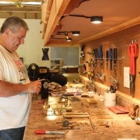 Al Hall disassembles the flyball governor in his workshop